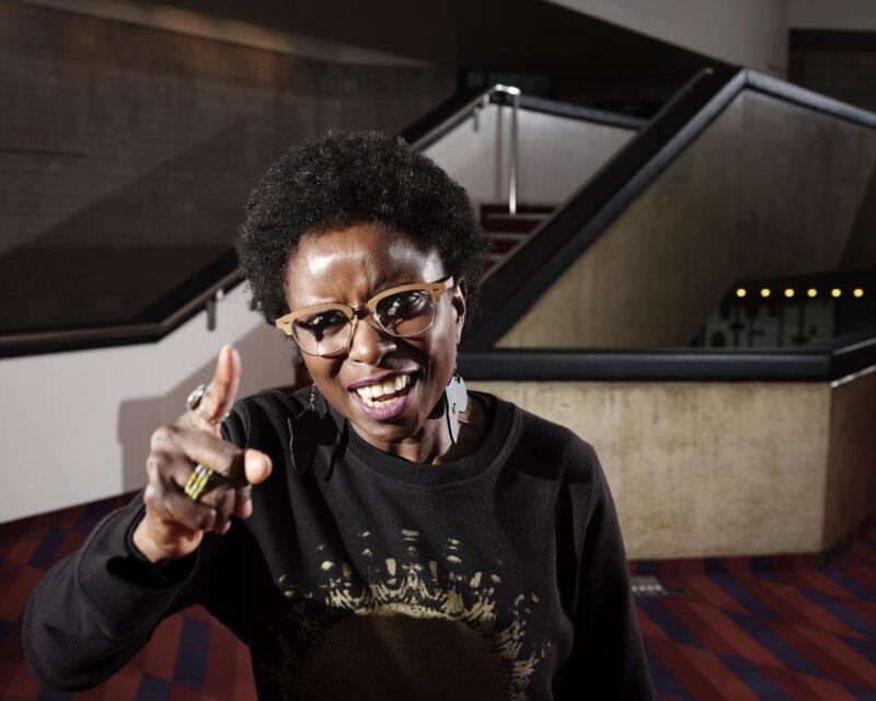 A woman, Mojisola Elufowoju, acting in the theater.