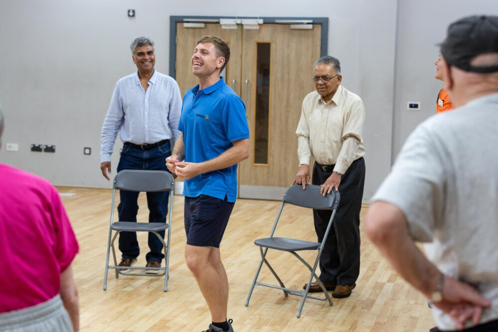 Adam Hazlewood (centre) leads a Happy and Healthy class at the Great Sankey Neighbourhood Hub