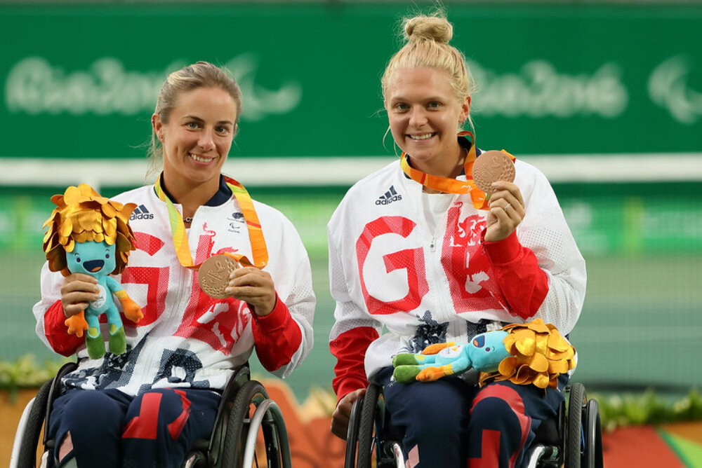Jordanne Whiley and Lucy Shuker celebrating their win in a competition.