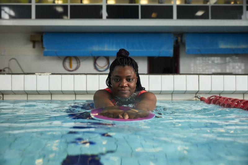 A black woman swimming